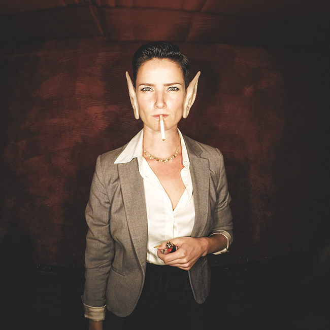 Selfie photo booth image of beautiful girl smoking with pointy ears at wedding party in Berlin Germany