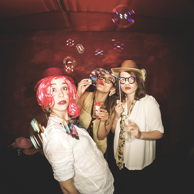 Selfie photo booth image of people having fun with soap bubbles at wedding party in Berlin Germany
