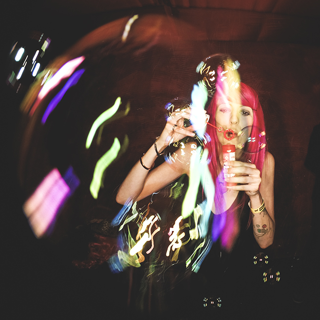 Selfie photo booth image of beautiful girl having fun with soap bubbles at wedding party in Berlin Germany