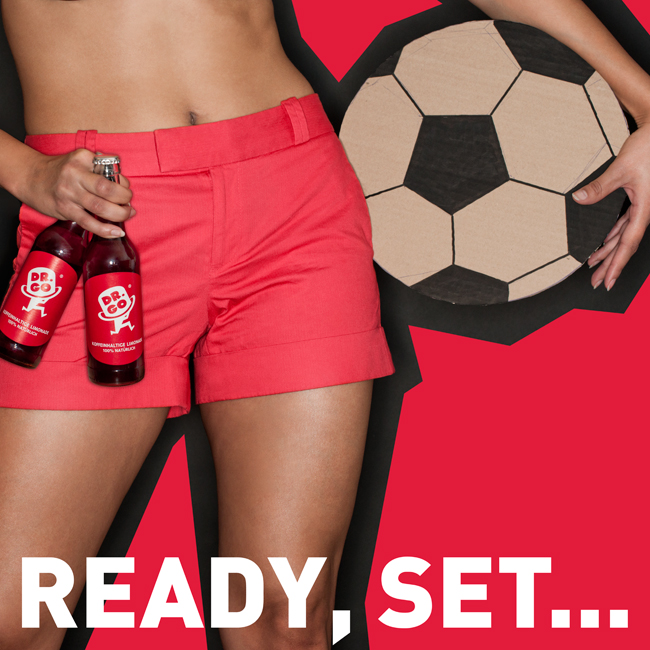 Red shorts and cardboard soccer ball - Beverage advertising campaign Berlin