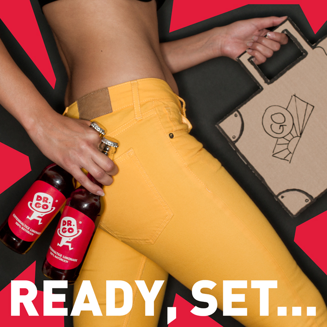 Yellow jeans and cardboard suitcase - Beverage advertising campaign Berlin